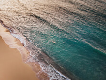 Aerial Drone View Of Lone Surfer At The Paradise Beach At Sunset In Las Terrenas, Samana, Dominican Republic