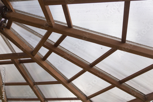 Cuadros en Lienzo closeup to a ceiling with joining wooden beams and transparent polycarbonate