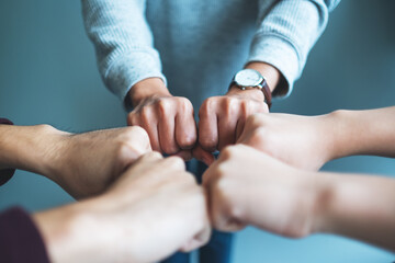 Group of business team work join their hands together with power and successful concept