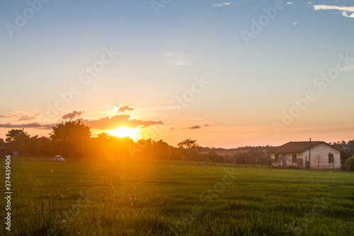 Fototapeta sunrise over the field obraz