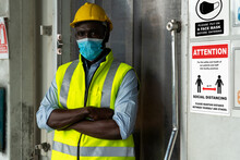Caution Sign In Factory Warning To Industry Labor Worker To Prevent Covid-19 Coronavirus Spreading During Job Business Reopening Period After Epidemic Crisis . Working Safely Concept .