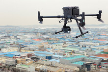 Industrial Drone Flies Over Fa...