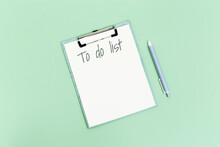 To Do List On Mint Colored Paper Background. Mock Up White Sheet. Strategy And Planning. Flat Lay. Top View.