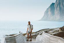 Man Traveler Walking On Seaside Exploring Norway Travel Solo Summer Vacations Active Healthy Lifestyle Eco Tourism Outdoor