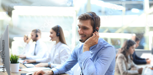 Fotografia Portrait of call center worker accompanied by his team