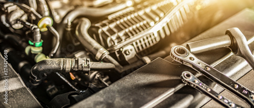 Fotografiet Auto mechanic working and repair on car engine in mechanics garage