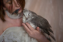 Portrait Of A Girl And A Chick Of A River Gull.