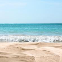 Ocean Waves Rolling On Sandy Beach, Closeup View