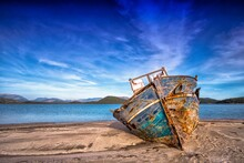 Shipwreck On The Beach