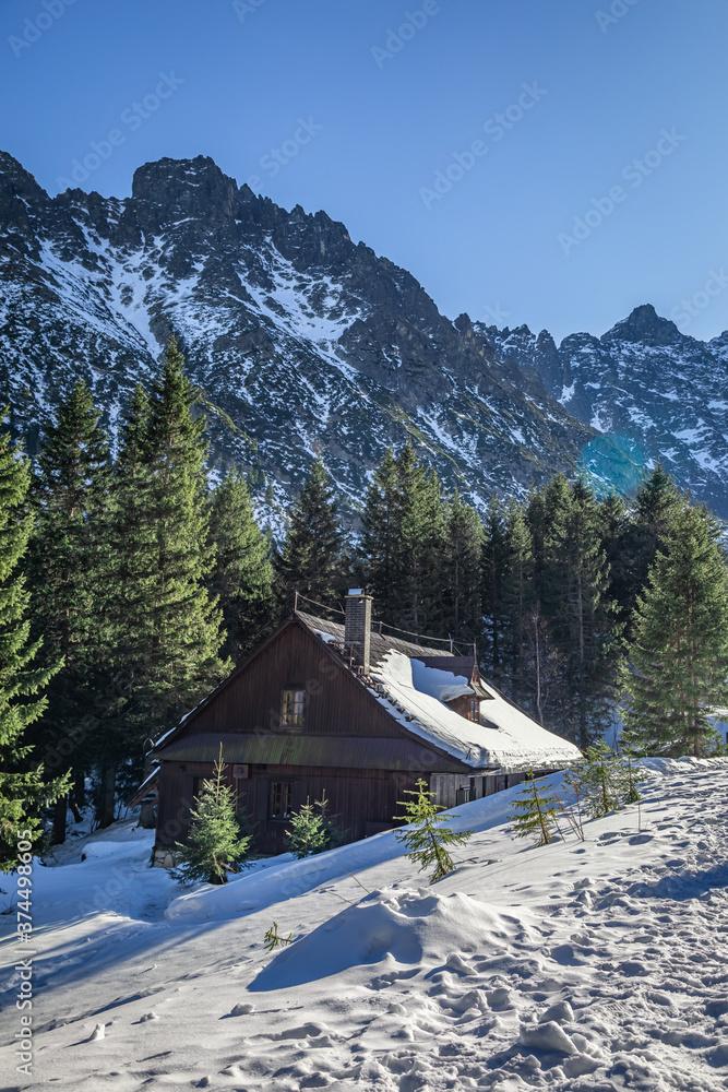 Wooden mountain shelter by sea eye lake in winter, Tatras