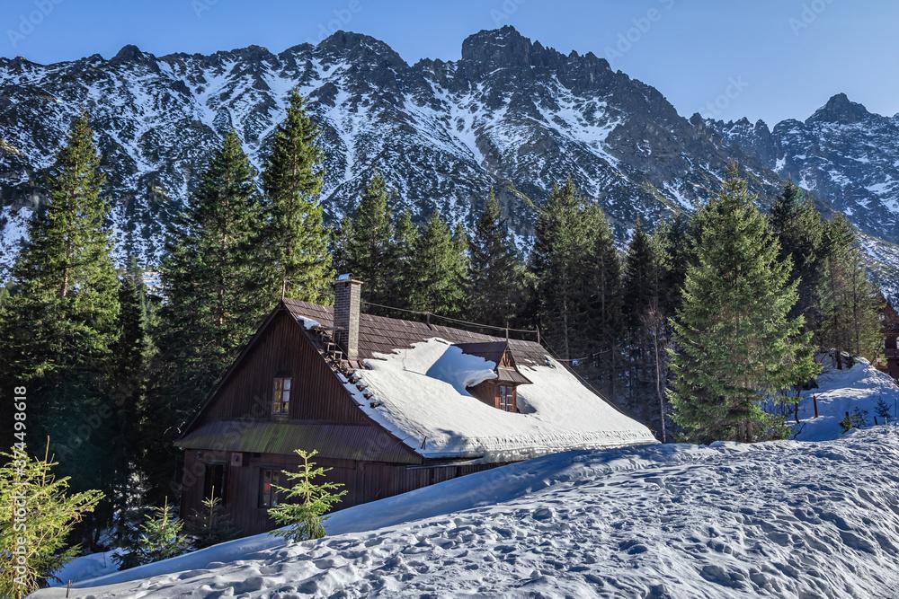 Sonowy mountain shelter by sea eye lake in winter, Tatras