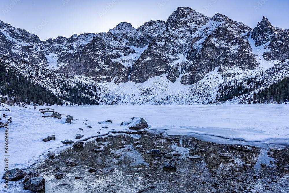 Wonderful covered by snow Morskie Oko lake in Tatra mountains