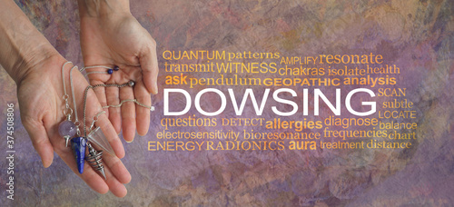 Words associated with dowsing - female hand showing a selection of dowsing pendu Wallpaper Mural