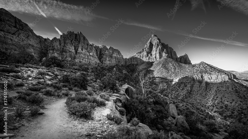 Fototapeta Black and White Photo of reaching the end destination of the Watchman Hiking Trail in Zion National Park in Utah, USA during a sunrise hike