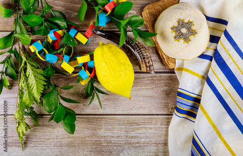 Jewish festival of sukkoth over paper colorful chain garland on kippah Wallpaper Mural
