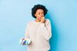canvas print picture - Middle age african american woman eating macaroons isolated biting fingernails, nervous and very anxious.
