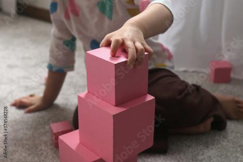 Toddler Building Montessori Pink Tower Wallpaper Mural