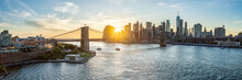 New York Skyline Panorama With Brooklyn Bridge At Sunset