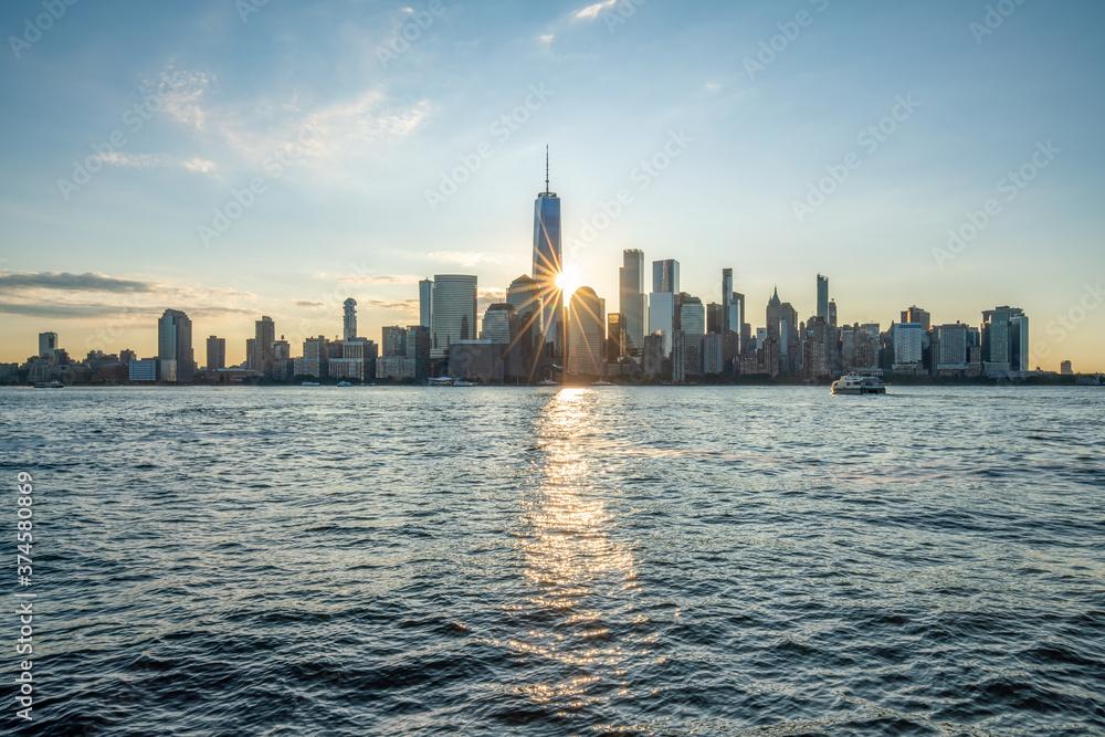 Fototapeta Lower Manhattan skyline with One World Trade Center at sunrise
