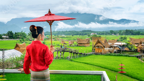 Asian women wearing Thai dress costume traditional according Thai culture at famous place in Nan province, Thailand Billede på lærred