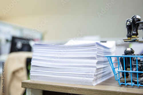Fotografie, Obraz Pile of a lots paper and paperwork report or printout document on desk office stack up for work hard and information concepts