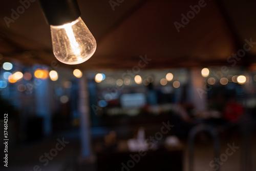 Cuadros en Lienzo NYC outdoor dining light bulb portrait