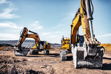 Group Of Yellow Excavator Working On Construction Open Mining Site