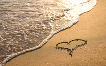 A Heart Is Drawn On The Sandy ...