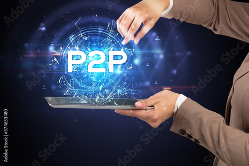 Photo Close-up of a touchscreen with P2P abbreviation, modern technology concept