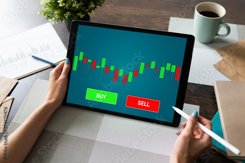 Fotografie, Tablou Online Trading Currency Forex Stock Market concept on screen with Economic graphs Candle chart and SELL and BUY buttons