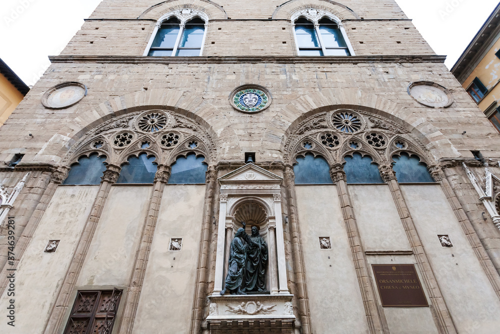 FLORENCE, ITALY - NOVEMBER 5, 2016: building of Orsanmichele church with statue Christ and St Thomas. Church was originally built as a grain market in 1337 on the site of kitchen garden of monastery