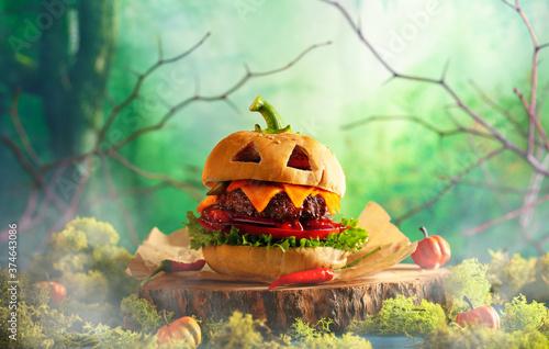 Carta da parati Halloween party burger in shape of scary pumpkin   on natural wooden board