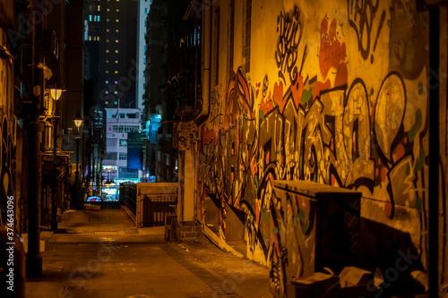 Dark alley with graffiti in Hong Kong Wallpaper Mural