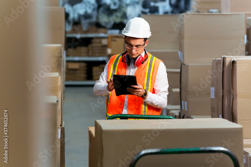 Fotografie, Tablou Employee of a logistics warehouse conducts an inventory of products