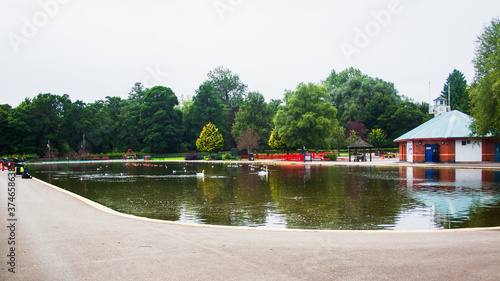 Photo Derby United Kingdom August 29, 2020:The boating Lake at Markeaton Park, Derby, Derbyshire, United Kingdom with a collection, of Swans, Geese and Ducks