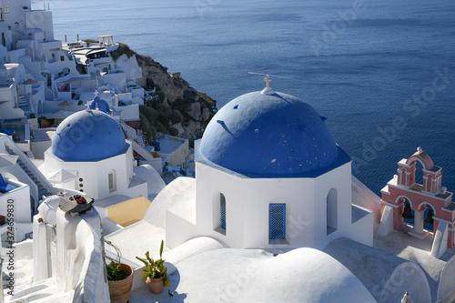 Fotografie, Obraz Blue domes of Oia on Santorini