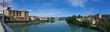 Panoramic view of the Isere river on the Old Bridge connecting Romans-sur-Isere to Bourg de Peage