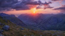 SUNSET OVER GLENCOE IN SCOTLAN...