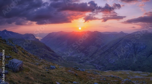 SUNSET OVER GLENCOE IN SCOTLAND.PANORAMIC VIEW.LANDSCAPE .ECOSSE.GLENCOE.MOUNTAINS. HILLS. SUN