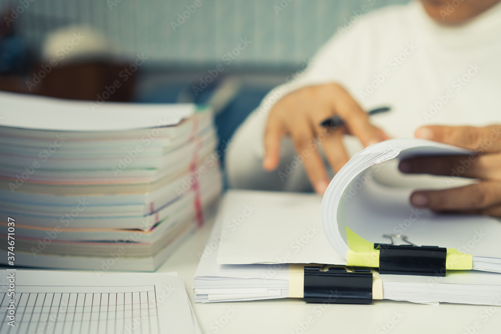 Fototapeta Auditor businesswoman checking unfinished document legal prepare paperwork or report for analysis information in TAX time, accountant in workload data contract partner deal in workplace at office