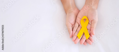 Fotografiet Suicide prevention and Childhood Cancer Awareness, Yellow Ribbon for supporting people living and illness