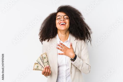 Fényképezés Young afro business woman holding a credit car isolated Young afro business woman holding a credit carlaughs out loudly keeping hand on chest