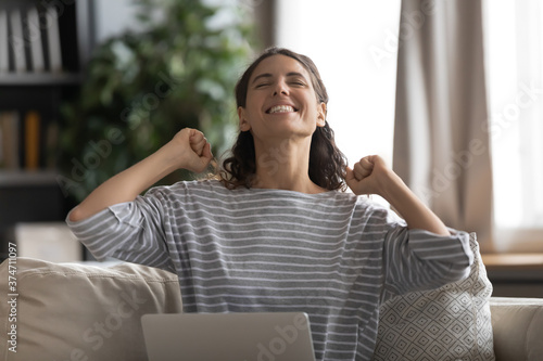 Head shot overjoyed excited young attractive woman received good news message notification on computer Canvas Print