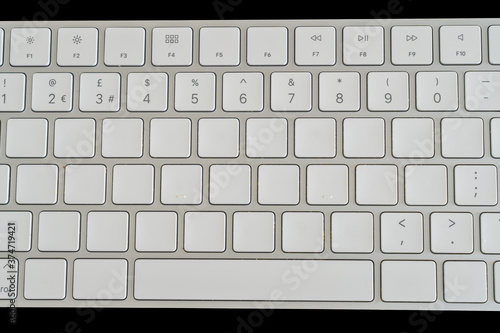 Tablou Canvas Blank white alphabet keys on a computer laptop keyboard with numbers  and action