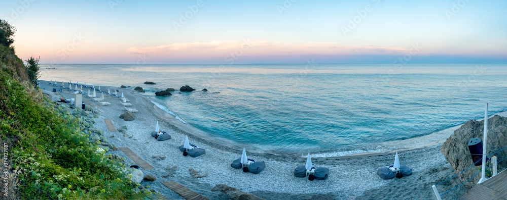 Fototapeta Panoramic view of a beach in Agiokampos, Greece at sunset.