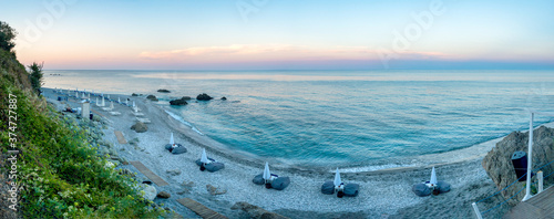 Obraz Panoramic view of a beach in Agiokampos, Greece at sunset. - fototapety do salonu