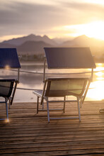 Two Empty Chairs On A Wooden P...