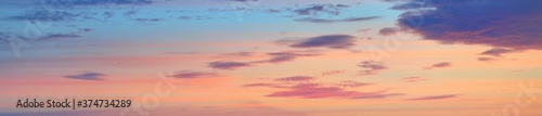 Colorful sky with glowing clouds in morning fog at sunrise Wallpaper Mural