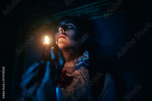 Fototapeta candle flame in the night