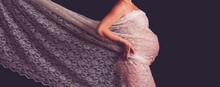 Pregnant Woman On A Black Back...